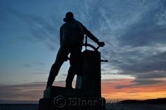 Man at the Wheel at Sunset