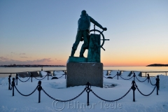 Man at the Wheel in Snow 1