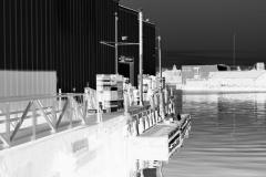 squam-creative-teele-warehouses-gloucester-harbor-bw-inversion