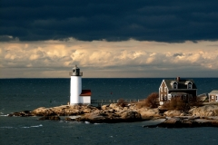 Lighthouse Under Stormy Skies