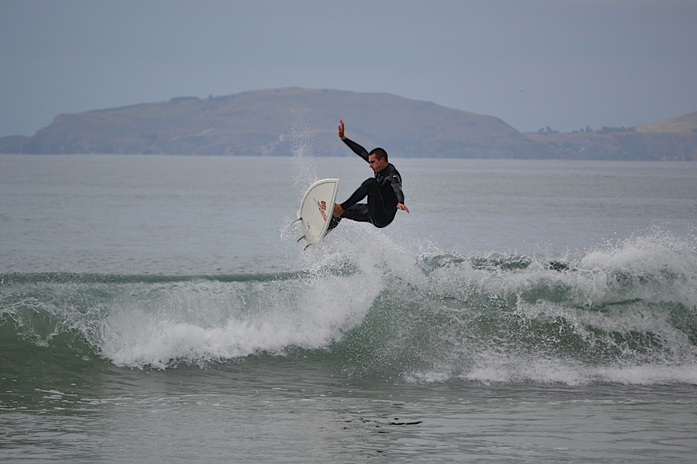Surfing, Karitane Beach, New Zealand